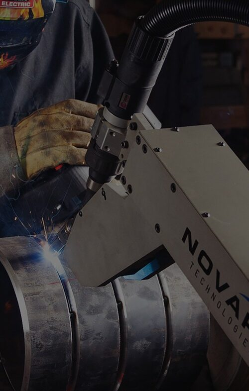 A welder working with a Novarc robotic welding machine